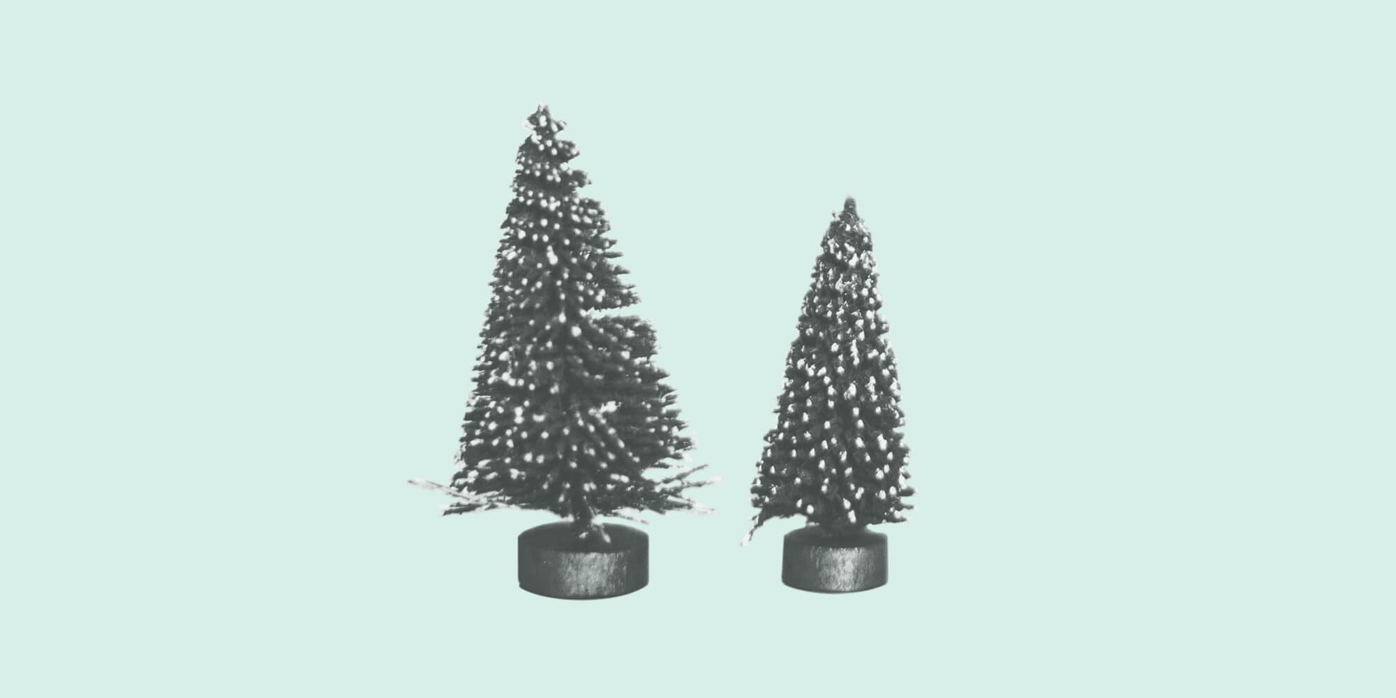 Tiny decorative pine trees on a light green background. Holiday Stress.