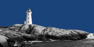 A lighthouse on a rocky shore. Addiction conselor.