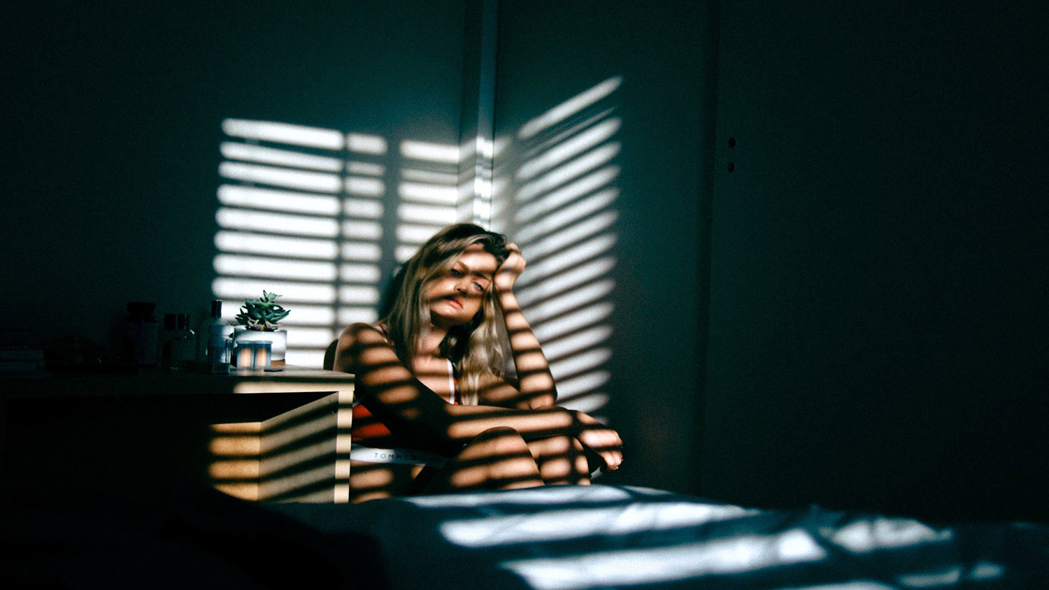 woman-with-blinds-shadow
