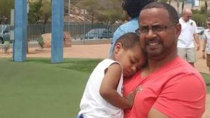 Demetrius holding his son in the park