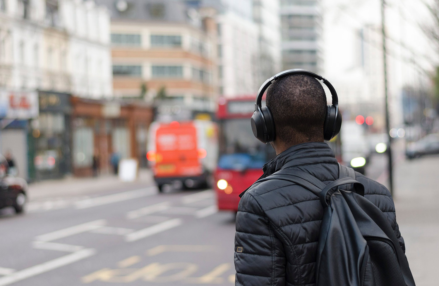 man-walking-with-headphones