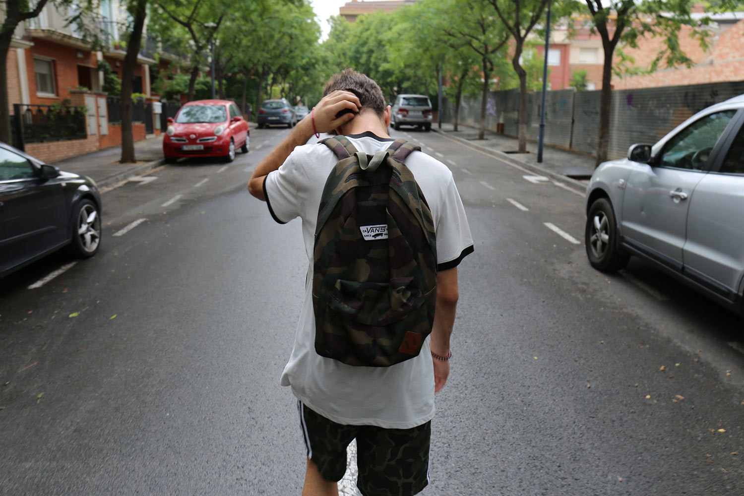 man-walking-with-backpack