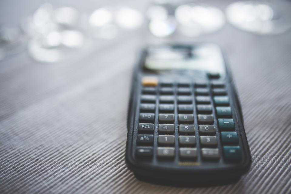 Close-up of a calculator. How much does your opiate addiction cost?