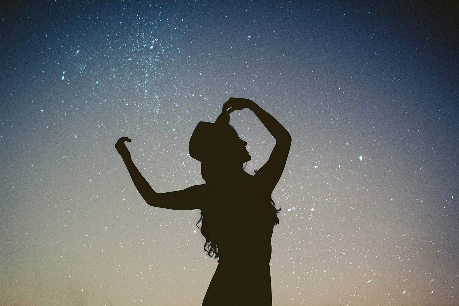 A dancing woman silhouetted by the stars. Life lessons in addiction recovery