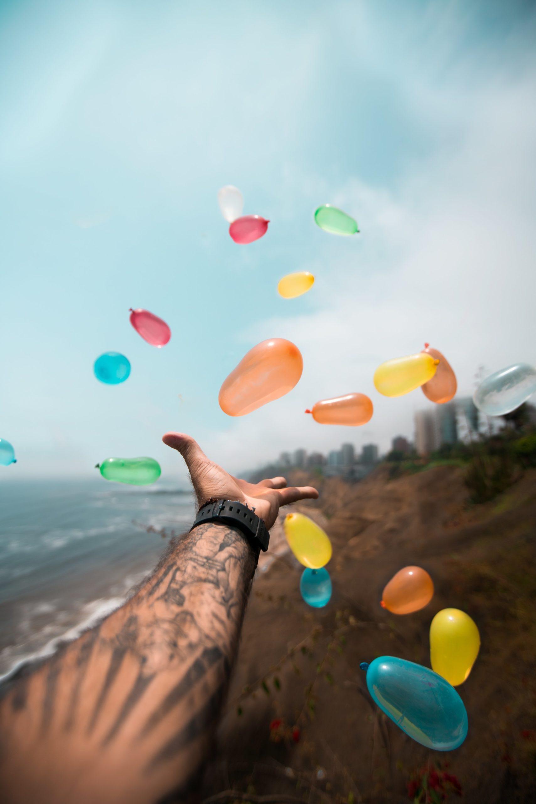 man-throwing-balloons