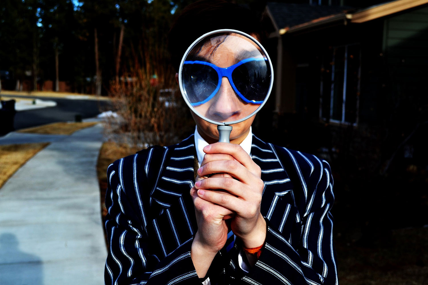 man-with-magnifying-glass