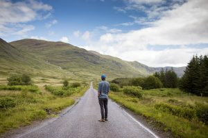 man-standing-on-road