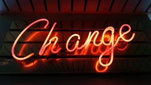 """Neon sign reading """"Change"""". New year"""