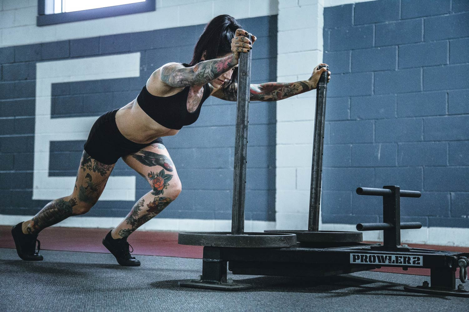 woman-pushing-weighted-sled