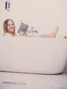 woman-reading-in-tub
