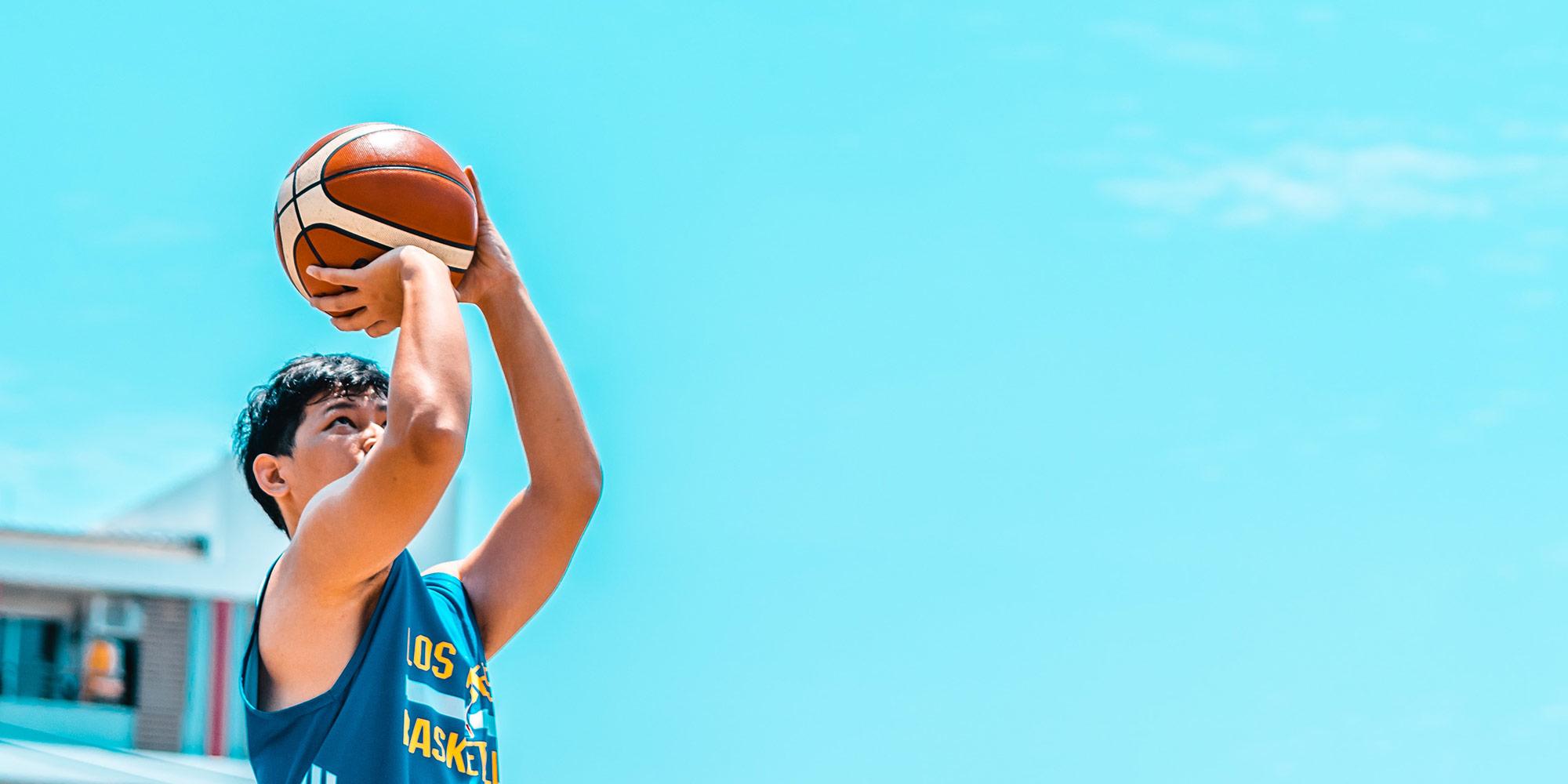 boy-playing-basketball