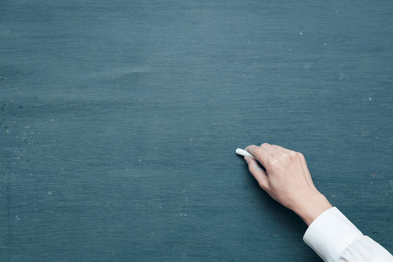 hand-chalk-board