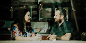 man-woman-talking-coffee-shop
