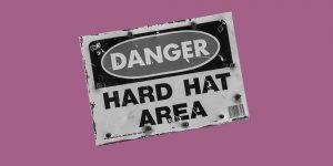 "Sign that read, ""Danger: Hard Hat Area"""