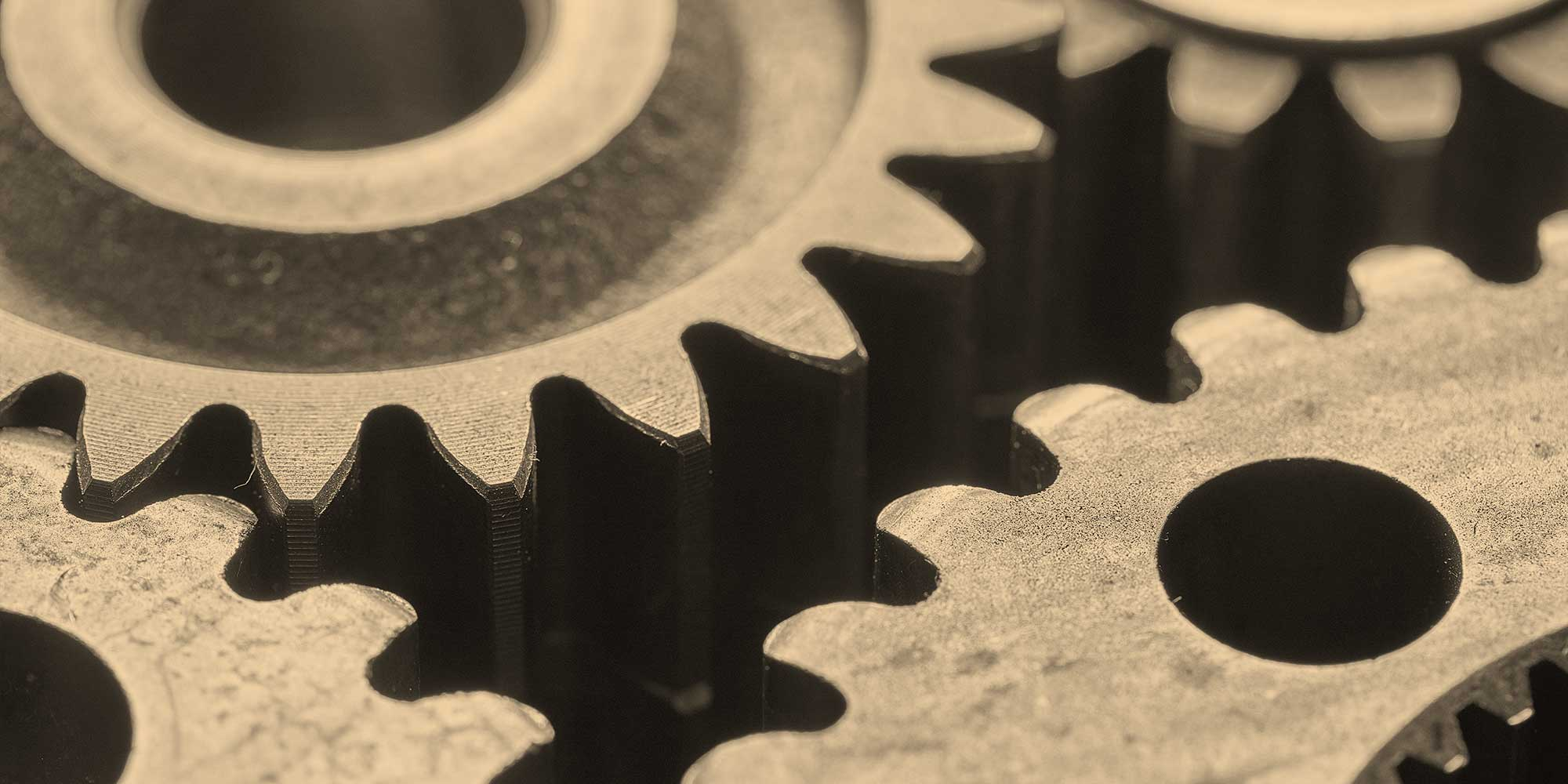 Gears turning together. employers-investing-employee-wellness