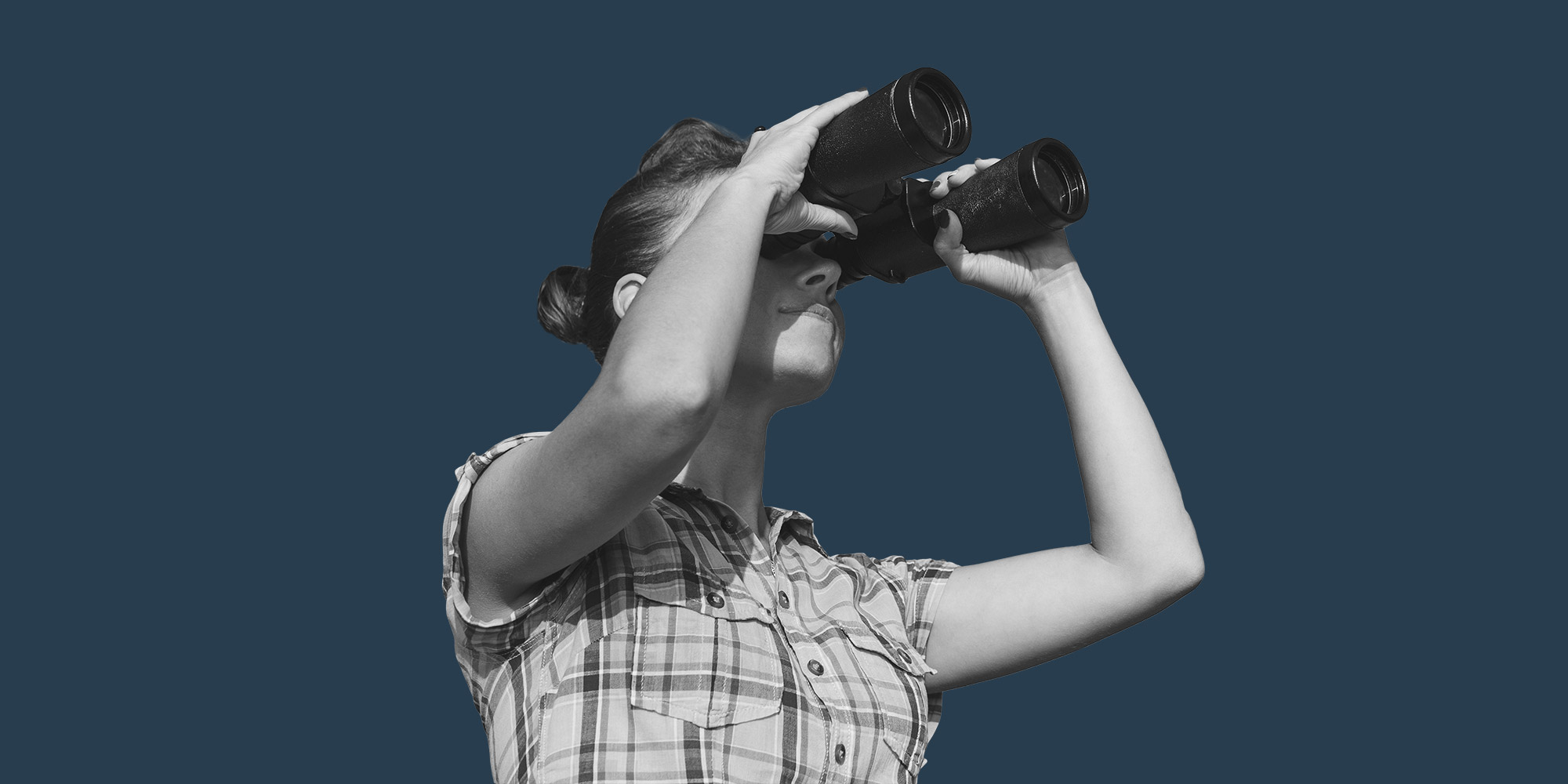 Woman with binoculars. looking for addiction treatment