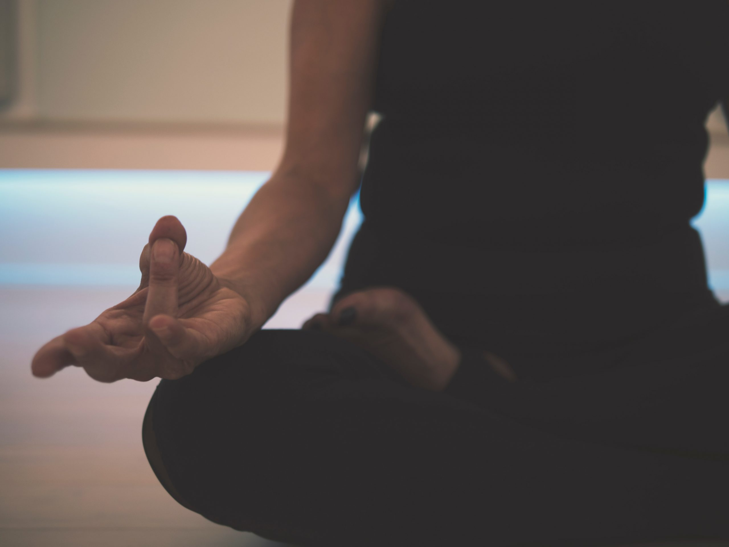 A person sitting in lotus position