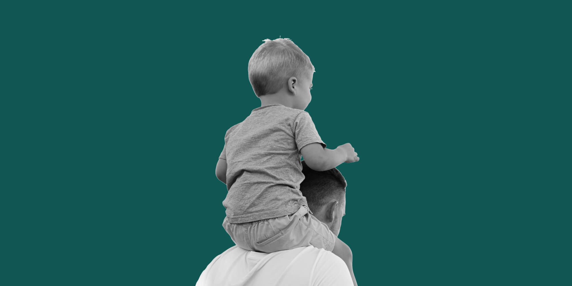 Small child on his father's shoulders. Recovery shapes fatherhood
