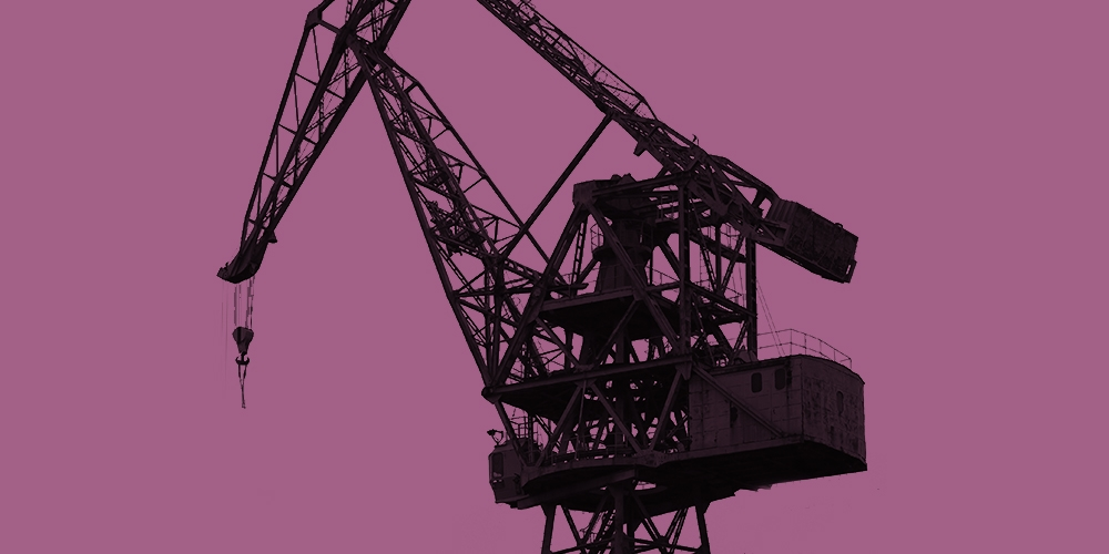 Grayscale photo of a construction crane against a magenta background