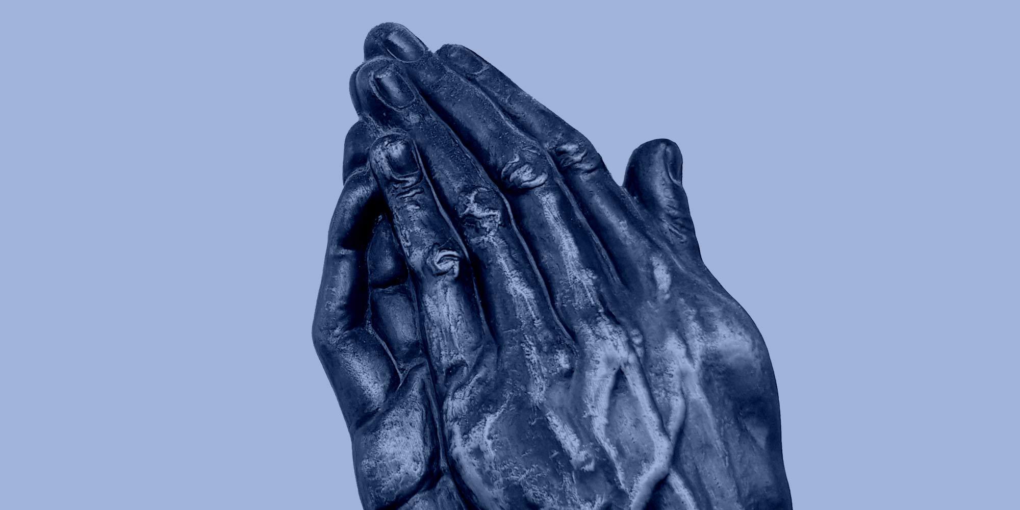 Sculpture of hands folded in prayer. The Serenity Prayer
