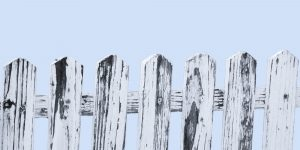 Wooden picket fence against a pale blue background. Boundaries are a gift