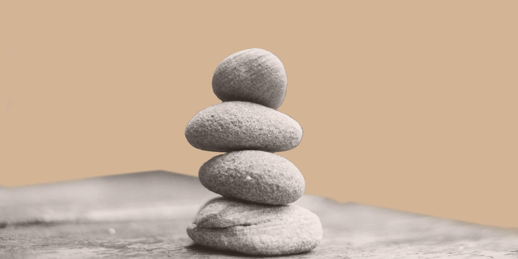 Four stones balanced atop one another. Slef-care