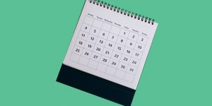 Monthly calendar on a green background. 30 day sobriety guide