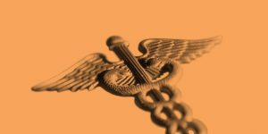Rod of Asclepius on an orange background. Workit Health introduces a hepatitis C clinic
