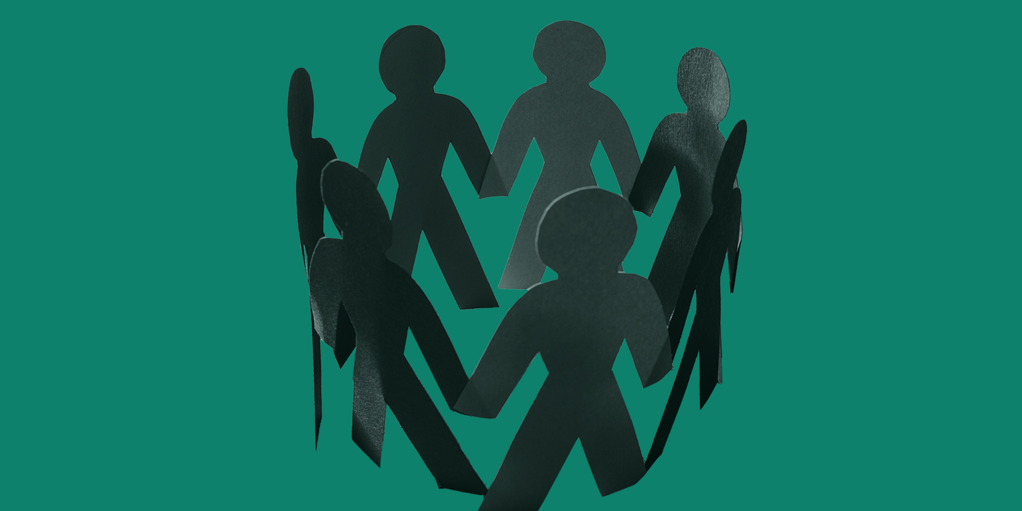 A circle of paper people holding hands. Substance use in the LGBTQIA community