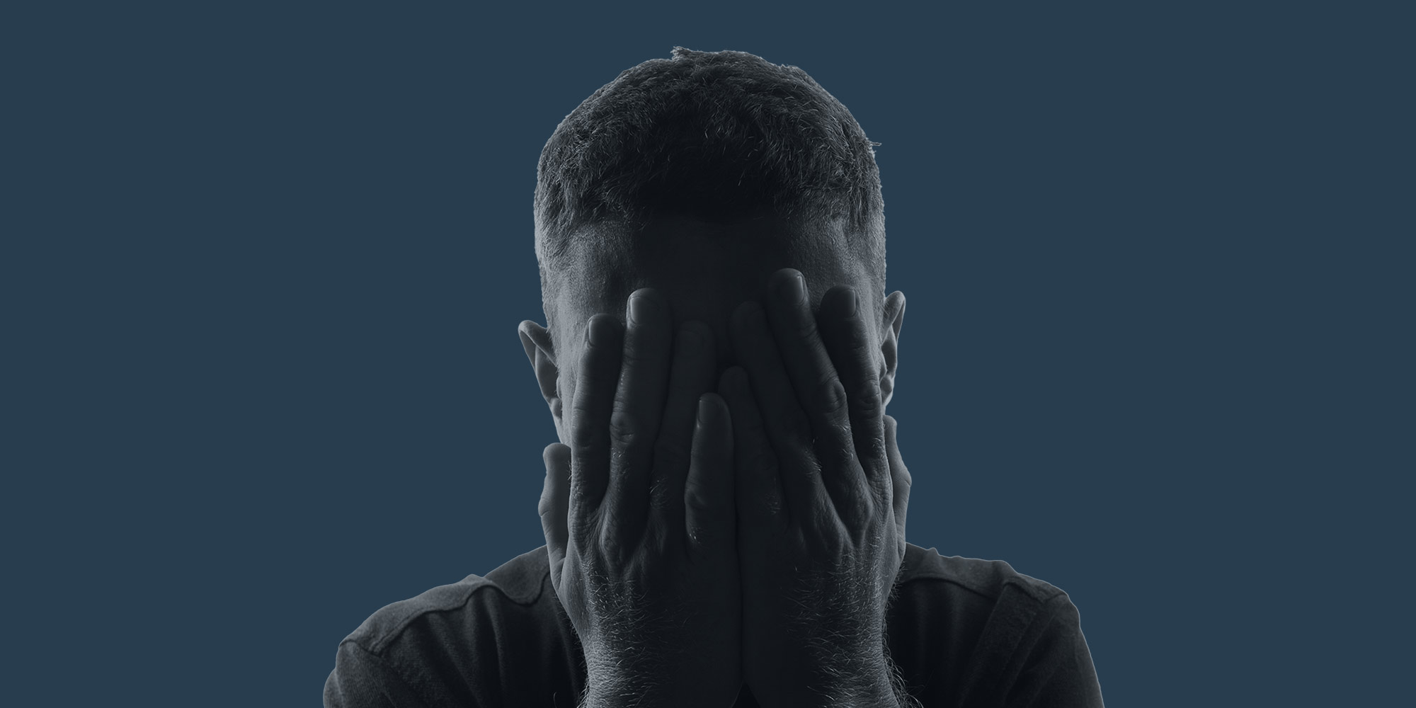 Man covering his face with his hands, depression