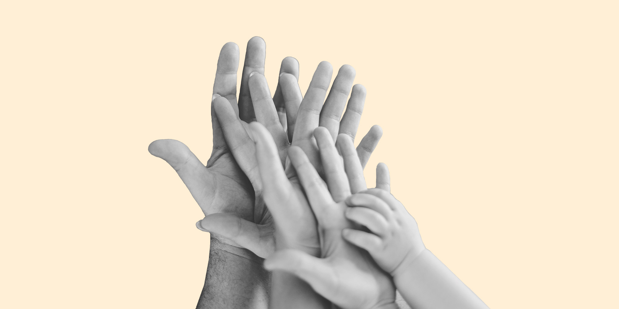 The hands of a man, woman, child, and baby, all pressed together. Parenting in recovery: Communication is key