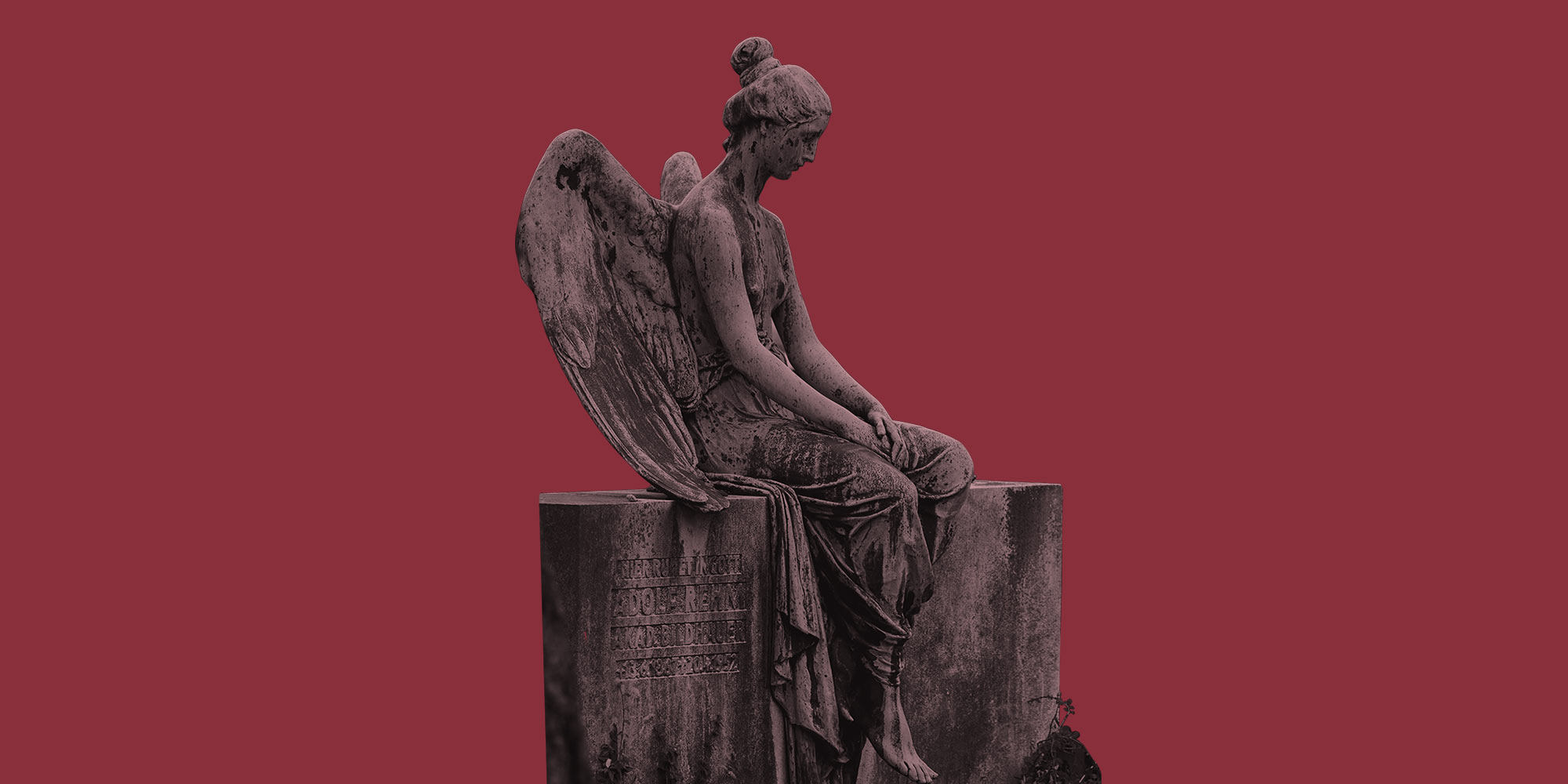 A stone angel statue in a cemetery. Grief and recovery