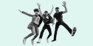 A trio of young adults jumping in the air and smiling. A new generation of recovery.