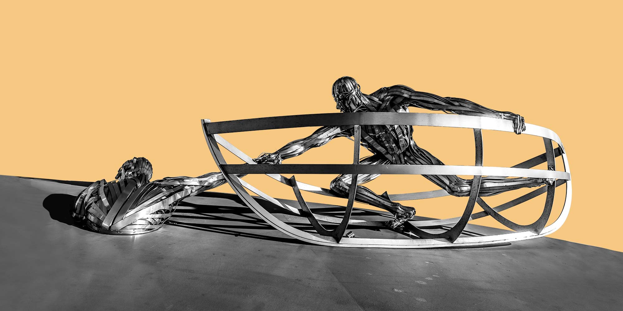 Metal sculpture of a person in a boat lifting a second person from the water. Harm Reduction