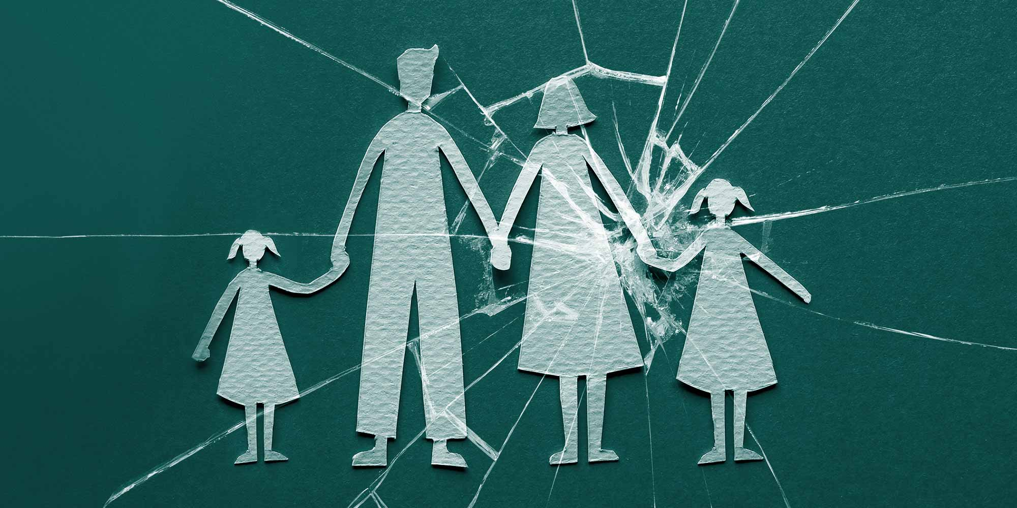 Paper cutouts of a family holding hands, with cracked glass centered over mother and daughter. Adult child of an alcoholic
